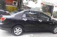 Cần bán gấp Toyota Corolla altis đời 2003, màu đen chính chủ giá 235 triệu tại Hà Nội