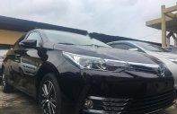 Cần bán xe Toyota Corolla 1.8G CVT 2018, màu đen giá 718 triệu tại Tp.HCM