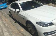 Bán ô tô BMW 5 Series 520i năm sản xuất 2014, màu trắng, giá tốt giá 1 tỷ 650 tr tại Tp.HCM