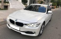 Cần bán lại xe BMW 3 Series 320i sản xuất 2013, màu trắng, giá tốt giá 880 triệu tại Tp.HCM