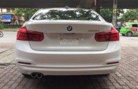 Bán BMW 3 Series 320i LCI model 2016, màu trắng, nội thất kem giá 1 tỷ 140 tr tại Hà Nội