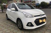 Bán xe Hyundai Grand i10 1.0 MT, Sx cuối 2014 đăng ký 2015, màu trắng, xe nhập khẩu, hỗ trợ trả góp 70% giá xe giá 305 triệu tại Hà Nội