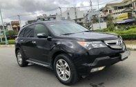 Acura MDX 7 chỗ ĐK 2009 nhập Mỹ, loại cao cấp hàng full. Màu đen xe có đủ đồ giá 695 triệu tại Tp.HCM