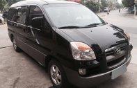 Mình bán Hyundai Starex 2006 dầu, màu đen, xe mình giữ kỹ đẹp giá 235 triệu tại Tp.HCM
