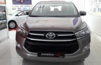 Toyota Innova 2.0E đời 2018 mới 100% màu đồng ánh kim, trả trước 170 triệu lấy xe ngay giá 718 triệu tại Tp.HCM