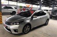 Bán Toyota Corolla Altis 1.8 số sàn đời 2015, màu bạc giá 620 triệu tại Tp.HCM