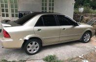 Cần bán lại xe Ford Laser đời 2003, màu vàng xe gia đình, giá chỉ 180 triệu giá 180 triệu tại Bình Dương