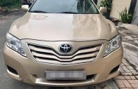 Bán xe Toyota Camry LE đời 2010, màu vàng giá 930 triệu tại Đồng Nai