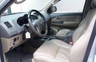 Cần bán gấp Toyota Fortuner 2.7V AT đời 2014, màu bạc xe gia đình giá 740 triệu tại Hà Nội