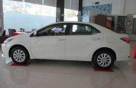 Bán Toyota Corolla altis 1.8E sản xuất 2018, màu trắng giá 687 triệu tại Tp.HCM