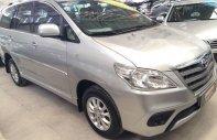 Cần bán lại xe Toyota Innova E năm sản xuất 2014, màu bạc số sàn, giá tốt giá 620 triệu tại Tp.HCM