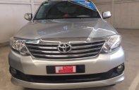 Bán xe Toyota Fortuner máy xăng 1 cầu đời 2012, màu bạc giá 710 triệu tại Tp.HCM