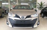 Bán xe Toyota Vios 1.5 E CVT năm 2018, màu vàng giá 569 triệu tại Hà Nội