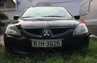 Cần bán gấp Mitsubishi Lancer năm sản xuất 2003, màu đen số tự động, giá tốt giá 229 triệu tại Bình Dương