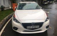 Cần bán gấp Mazda 3 1.5AT năm 2015, màu trắng số tự động, giá chỉ 615 triệu giá 615 triệu tại Tp.HCM