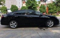Cần bán Toyota Camry 2.5Q AT đời 2016, màu đen chính chủ giá 1 tỷ 130 tr tại Hà Nội