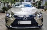 Cần bán gấp Toyota Camry sản xuất năm 2016, màu vàng còn mới giá cạnh tranh giá 870 triệu tại Tp.HCM
