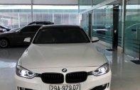 Cần bán lại xe BMW 320i sản xuất năm 2013, màu trắng, nhập khẩu nguyên chiếc, 888tr giá 888 triệu tại Hà Nội