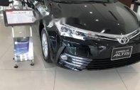 Bán ô tô Toyota Corolla Altis 1.8E CVT sản xuất năm 2018, màu đen giá 707 triệu tại Bình Phước