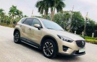 Cần bán Mazda CX 5 2.0 AT sản xuất năm 2016, màu vàng như mới giá 790 triệu tại Hà Nội