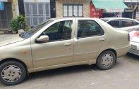 Bán Fiat Siena 1.6 HL, màu vàng cát, xe đang hoạt động bình thường, máy móc ổn định giá 65 triệu tại Hà Nội