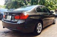 Bán BMW 320i 2014, chạy 8v chính chủ mới, xe nguyên zin 100% giá 885 triệu tại Hà Nội
