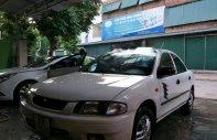 Cần bán Mazda 323 năm sản xuất 2002, màu trắng chính chủ, giá tốt giá 112 triệu tại Hà Nội
