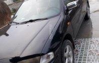 Bán xe Mazda 323 SX 1999, màu đen giá 125 triệu tại Nghệ An