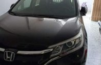 Cần bán lại xe Honda CR V AT đời 2015, màu đen, xe còn mới, chính chủ, giấy tờ đầy đủ giá 870 triệu tại Tp.HCM