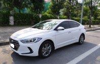 Bán Hyundai Elantra 1.6AT năm 2016, màu trắng, đúng 29000km giá 595 triệu tại Tp.HCM
