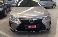 Bán ô tô Toyota Camry 2.0E 2016, màu vàng, xe nhập giá 925 triệu tại Tp.HCM