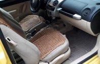 Cần bán xe cũ Volkswagen New Beetle 2.0 Turbo sản xuất 2005, màu vàng giá 118 triệu tại Tp.HCM