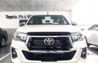 Bán xe Toyota Hilux năm sản xuất 2018, nhập khẩu giá 695 triệu tại Tp.HCM