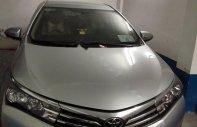 Cần bán xe Toyota Corolla Altis 1.8 đời 2014, màu bạc, mới 99% giá 650 triệu tại Tp.HCM