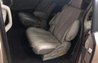 Gia đình cần bán xe Toyota Sienna dòng LE nhập Mỹ màu vàng cát giá 1 tỷ 395 tr tại Tp.HCM