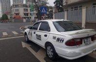 Bán Mazda 323 năm sản xuất 2005, màu trắng, xe nhập giá 108 triệu tại Hà Nội
