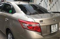 Bán Toyota Vios 1.5E năm 2017, màu vàng, xe gia đình giá 483 triệu tại Bình Dương