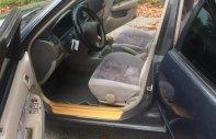 Gia đình cần bán xe Toyota Corolla 1.6Gli đời 1999, màu xám (ghi), nhập khẩu giá 195 tỷ tại Bình Dương