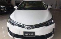 Bán ô tô Toyota Corolla altis 1.8E đời 2018, màu trắng, 718tr giá 718 triệu tại Tp.HCM