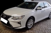 Đi nước ngoài bán Camry 2.0, màu trắng, Đk 4/2018, số tự động giá 932 triệu tại Tp.HCM