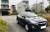 Gia đình cần bán xe Tucson 2010 đăng ký 2012, số tự động máy dầu, màu xám giá 675 triệu tại Tp.HCM