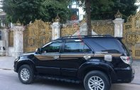 Chính chủ bán xe Toyota Fortuner 2.7V 4x2 AT năm 2013, màu đen giá 669 triệu tại Hà Nội