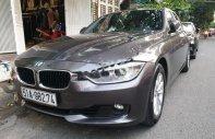 Cần bán xe BMW 3 Series 320i sản xuất năm 2014, màu xám, giá 900tr giá 900 triệu tại Tp.HCM