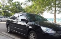 Cần bán xe Mitsubishi Lancer đời 2004, màu đen giá 218 triệu tại Hà Nội