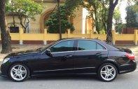 Gia đình cần bán xe Mercedes E300 AMG năm 2011, màu đen giá 1 tỷ 50 tr tại Hà Nội