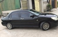 Cần bán xe Mitsubishi Lancer 1.8AT 2003, màu đen cọp giá 198 triệu tại Tp.HCM