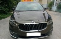 Bán xe Kia Sedona 2.2L DATH đời 2016, màu nâu chính chủ giá 990 triệu tại Hà Nội