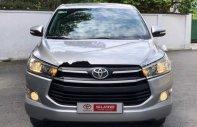 Cần bán lại xe Toyota Innova 2.0E đời 2017, màu bạc, số sàn giá 750 triệu tại Tp.HCM