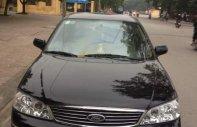 Cần bán Ford Laser 1.8 Ghia đời 2004, màu đen, nhập khẩu, xe đẹp giá 220 triệu tại Ninh Bình