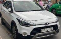Cần bán Hyundai i20 Active AT năm sản xuất 2015, màu trắng   giá 510 triệu tại Tp.HCM